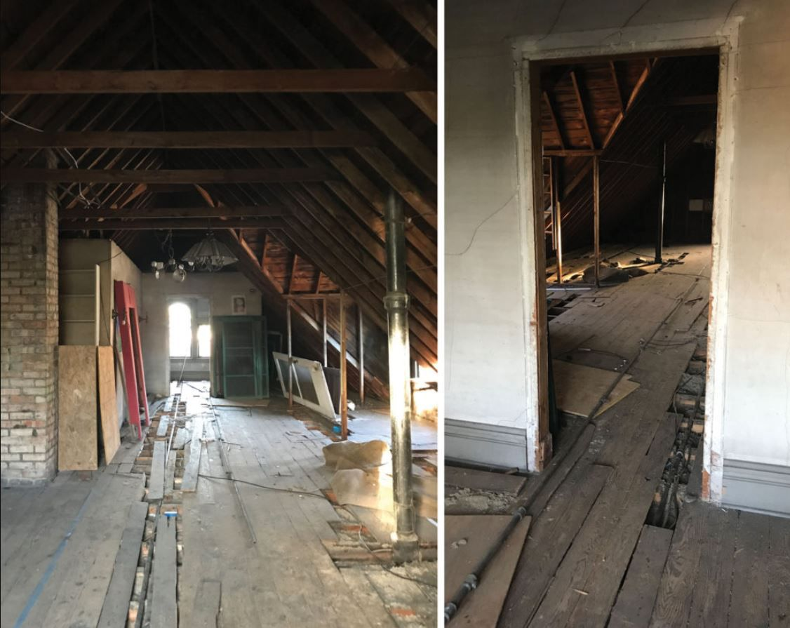 Unfinished attic with busted wood flooring.