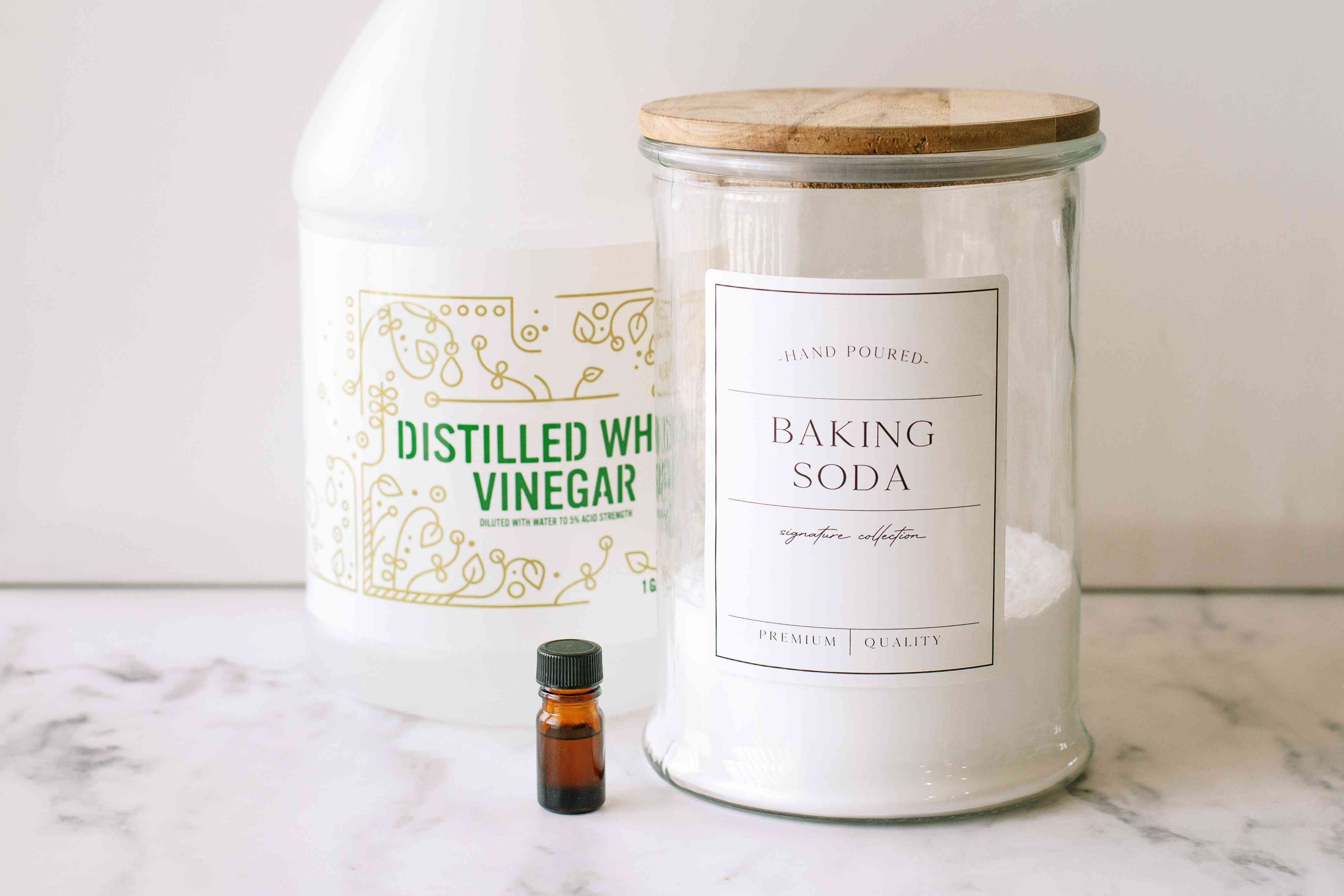 Homemade fabric softener with distilled white vinegar, baking soda and essential oil