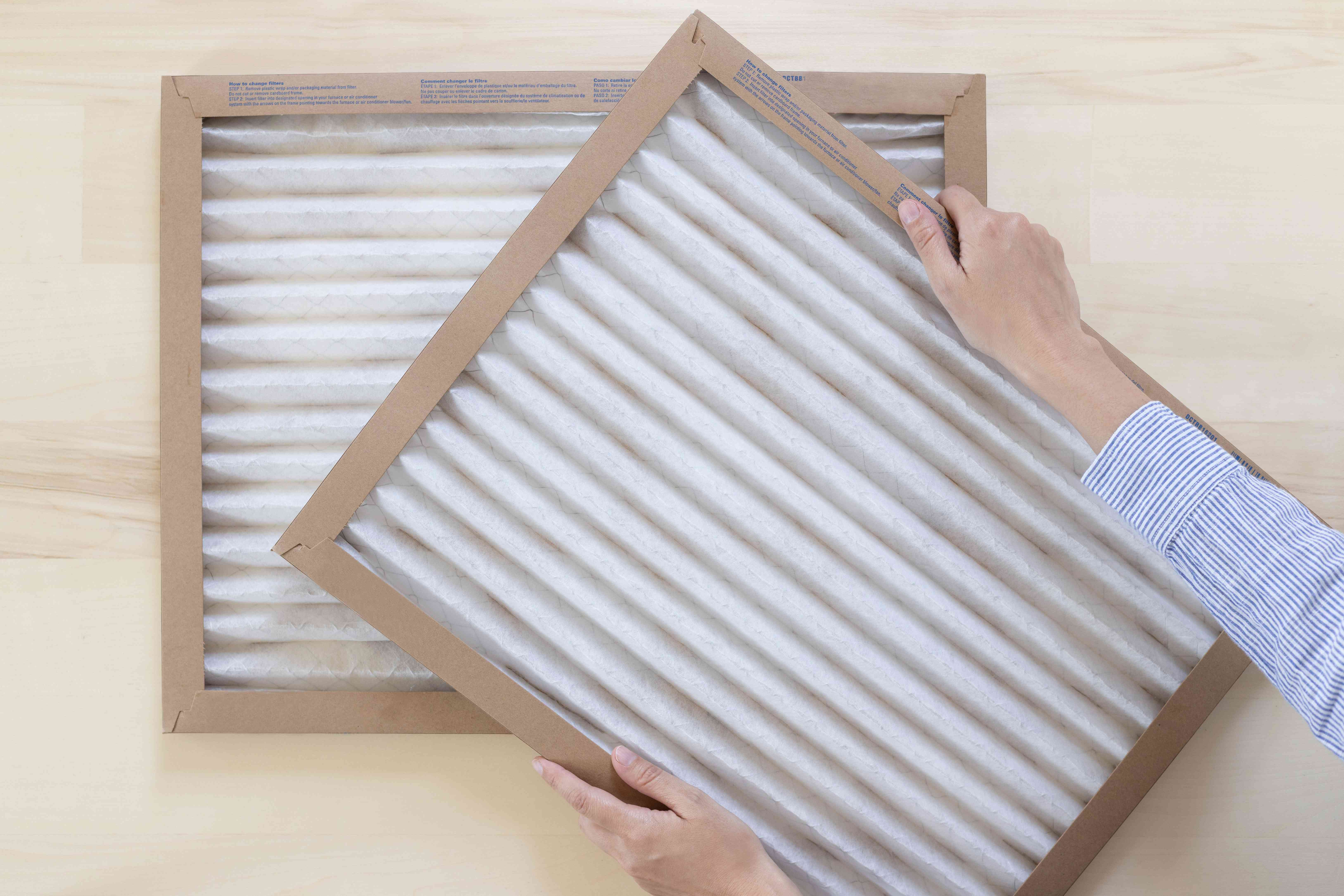 HVAC air filters stacked on each other to help lower electric bill