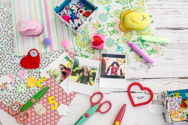 'Assortment of scrapbooking tools including colored paper, pens, and scissors.Click below for more of my scrapbooking and arts and crafts images: