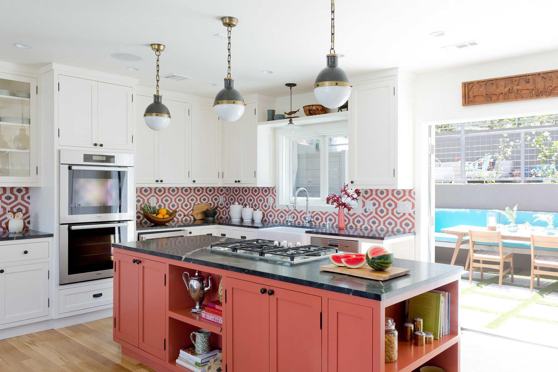 colorful kitchen with orange island