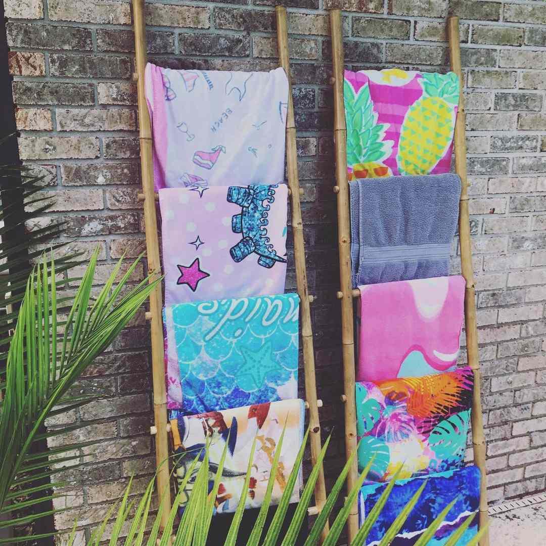Storage ladder with pool towels