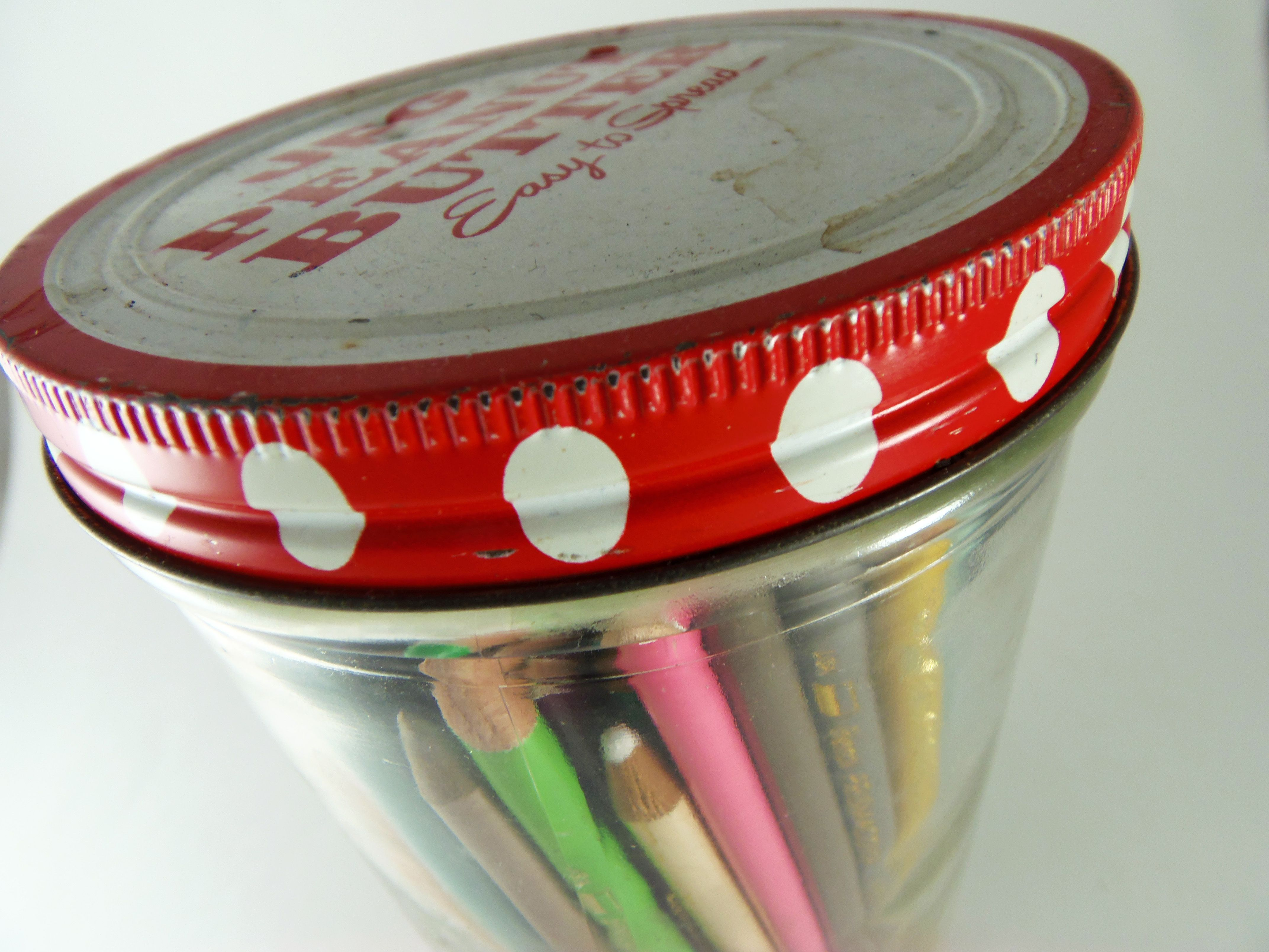 Colored pencils stored in jar