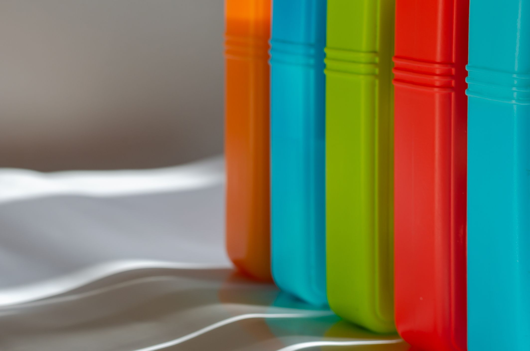 Multi-colored containers stored vertically.