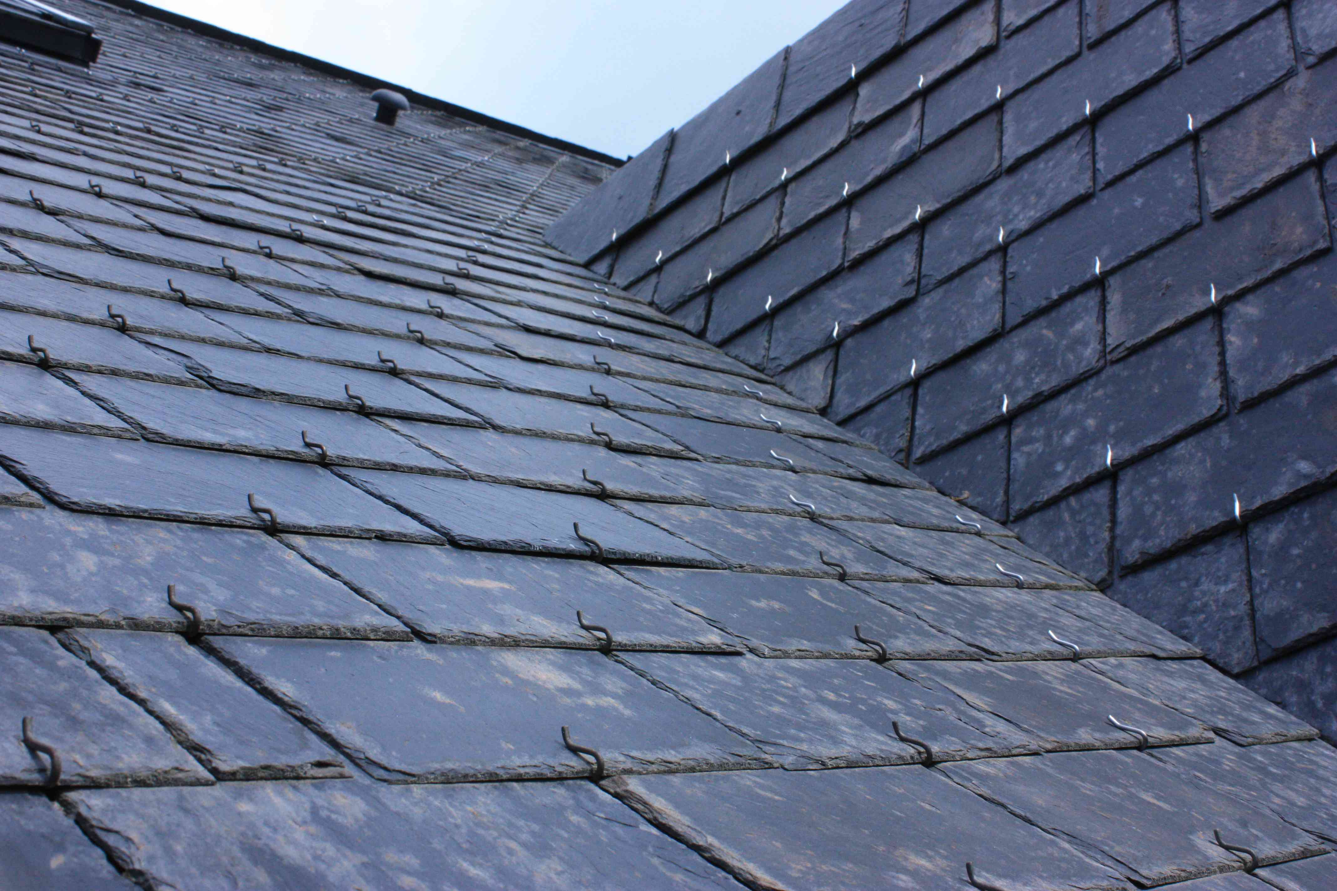 Roof of house in slate tiles