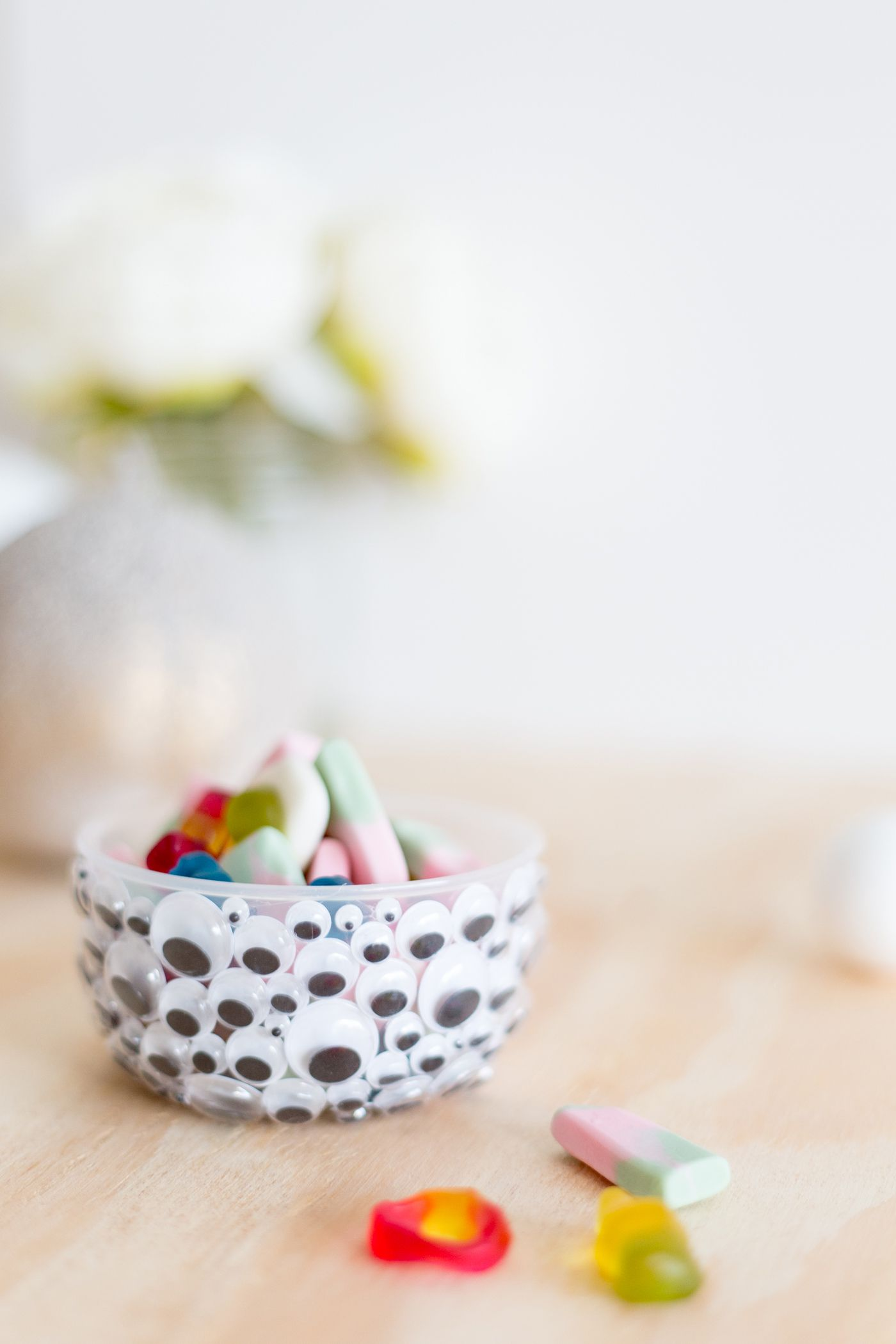 A bowl covered with googly eyes