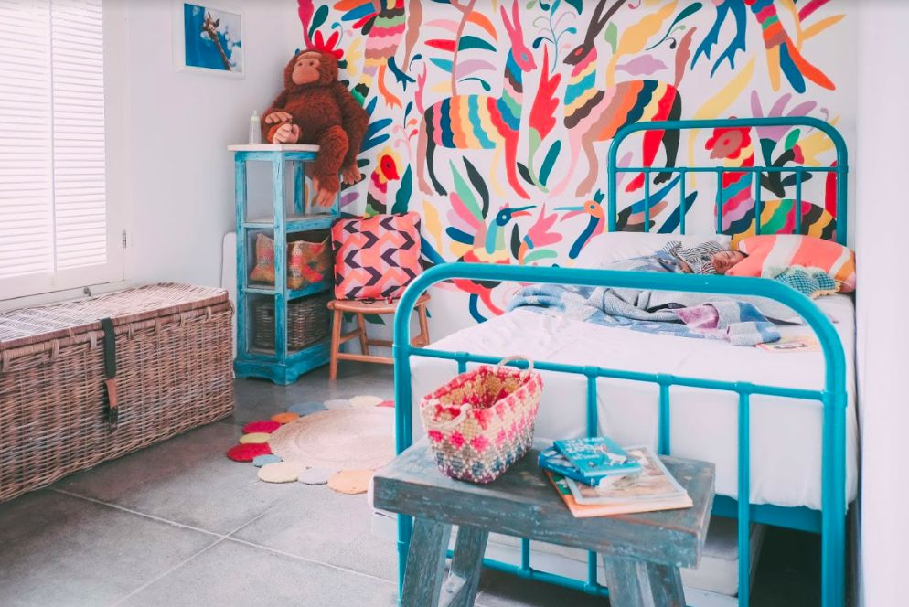Bed in a very colorful children's room