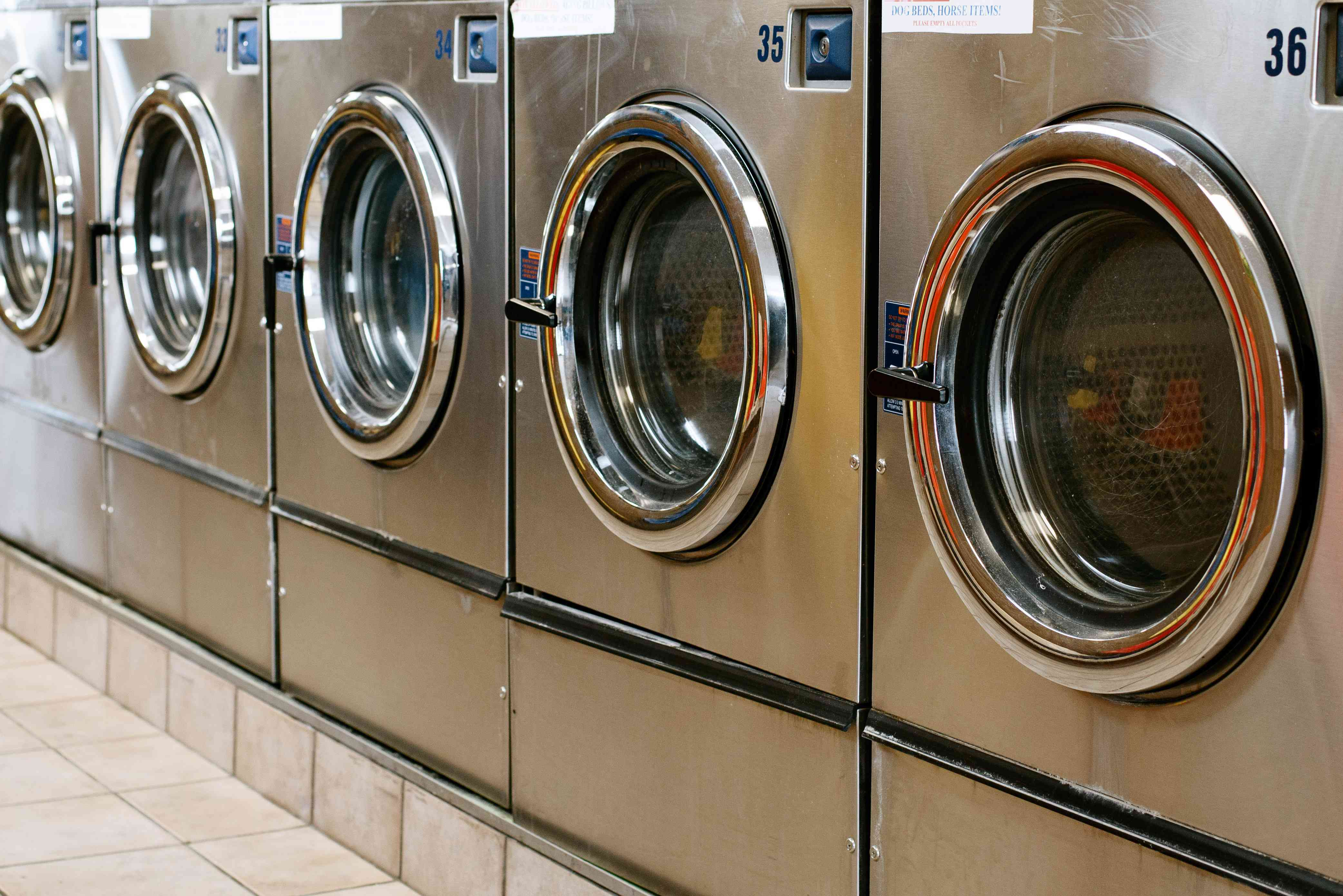 Front-loading washing machines in laundromat to go green