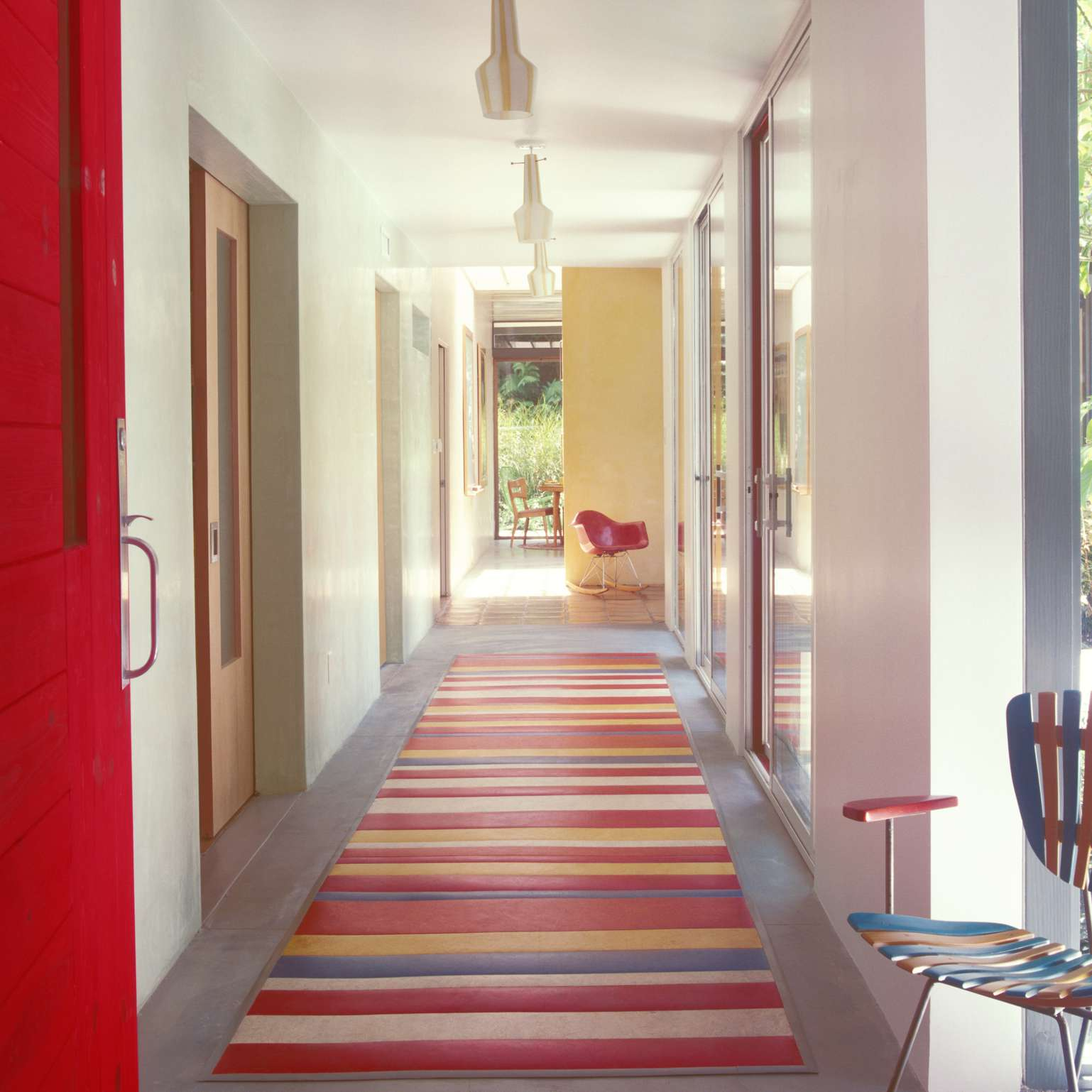 colorful hallway with a red, blue, and yellow runner