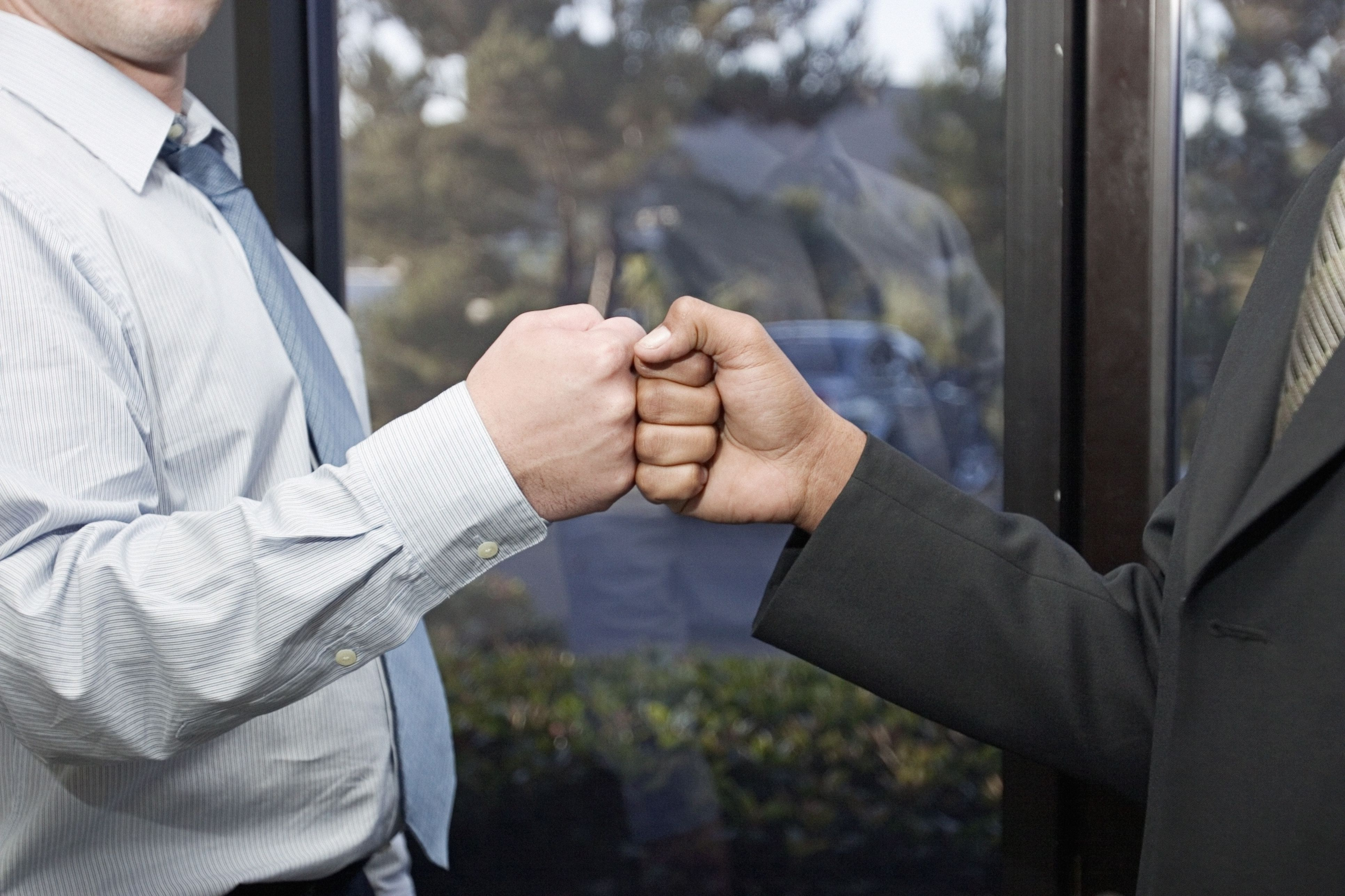 Businessmen bumping fists