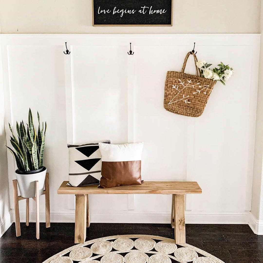 Entryway with wood bench