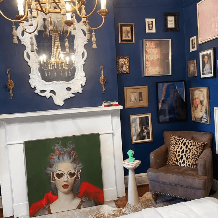 blue gallery wall in bedroom