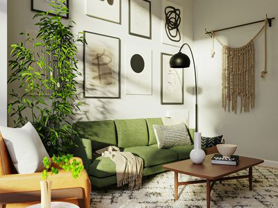 living room with green sofa, black accents and green plant