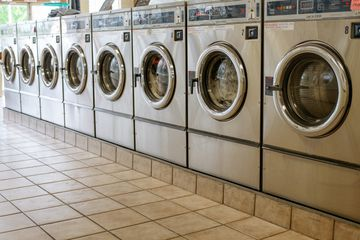Laundromat with washing machines and tiled floor
