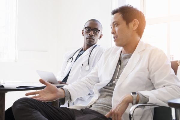 Professionals discussing in doctor's office