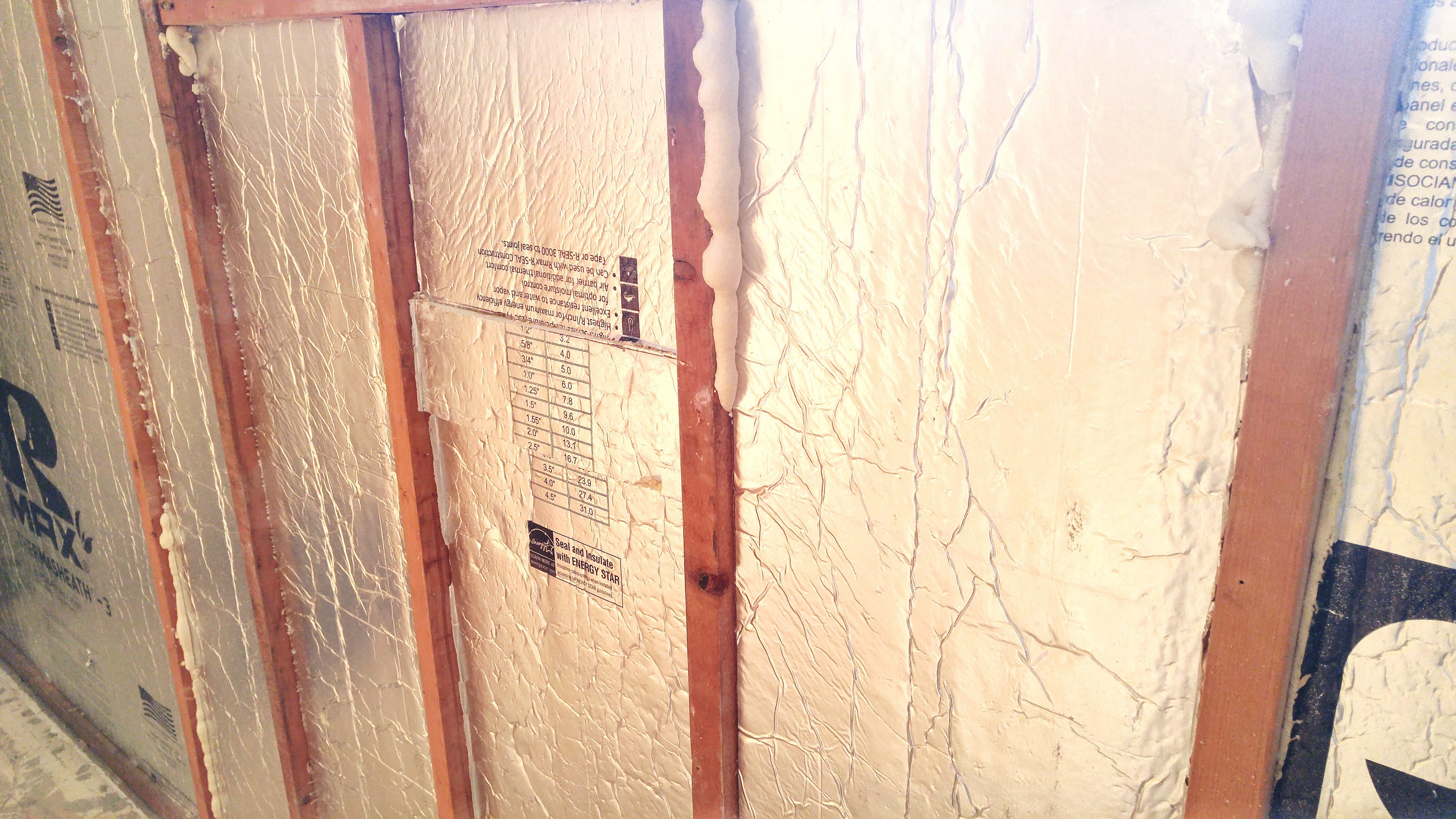 Installing Foam Board Insulation Between Studs