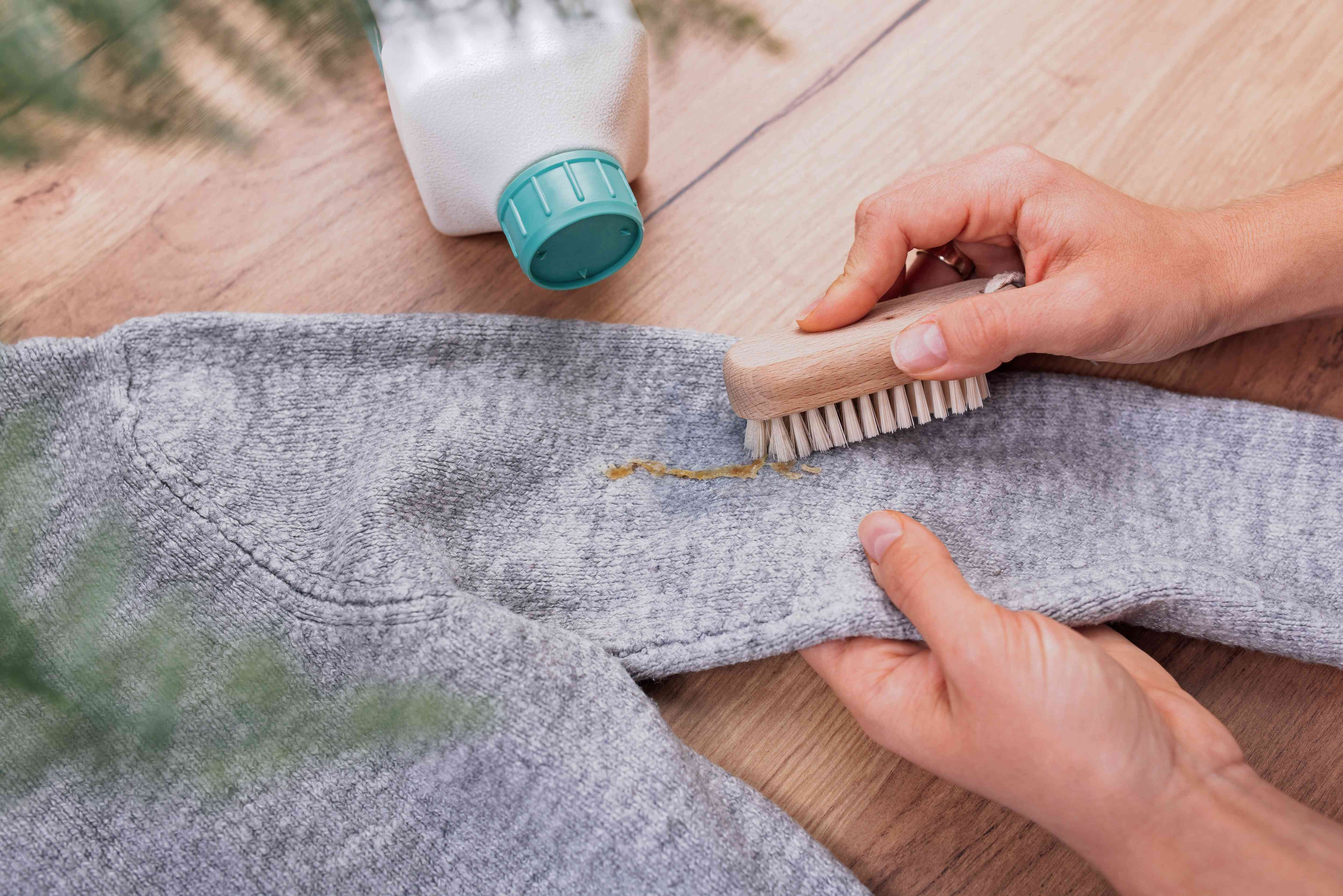 rubbing the stain with a soft brush