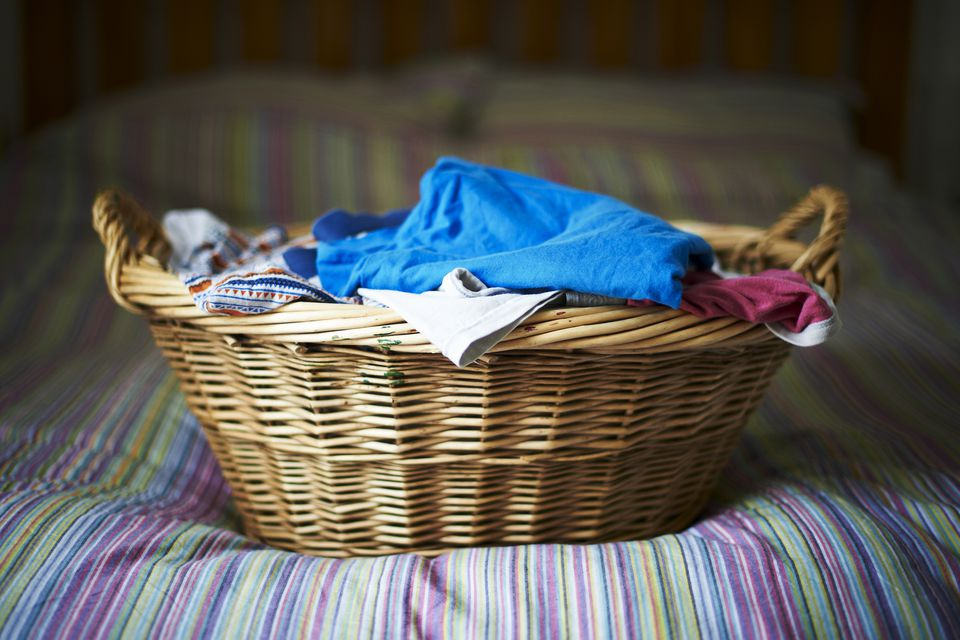 Filled Laundry Basket On Bed
