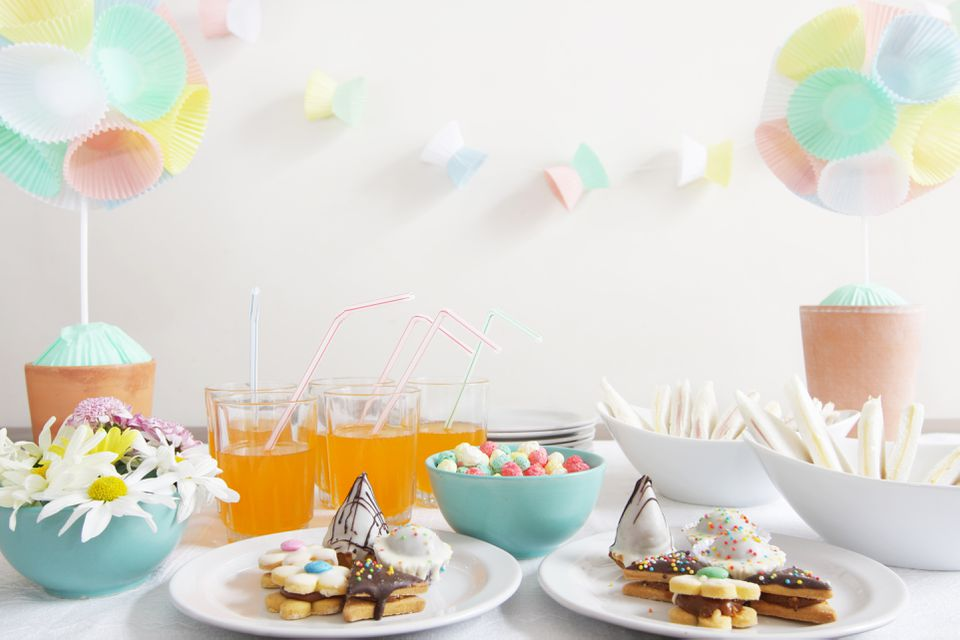 a table with party food and decorations