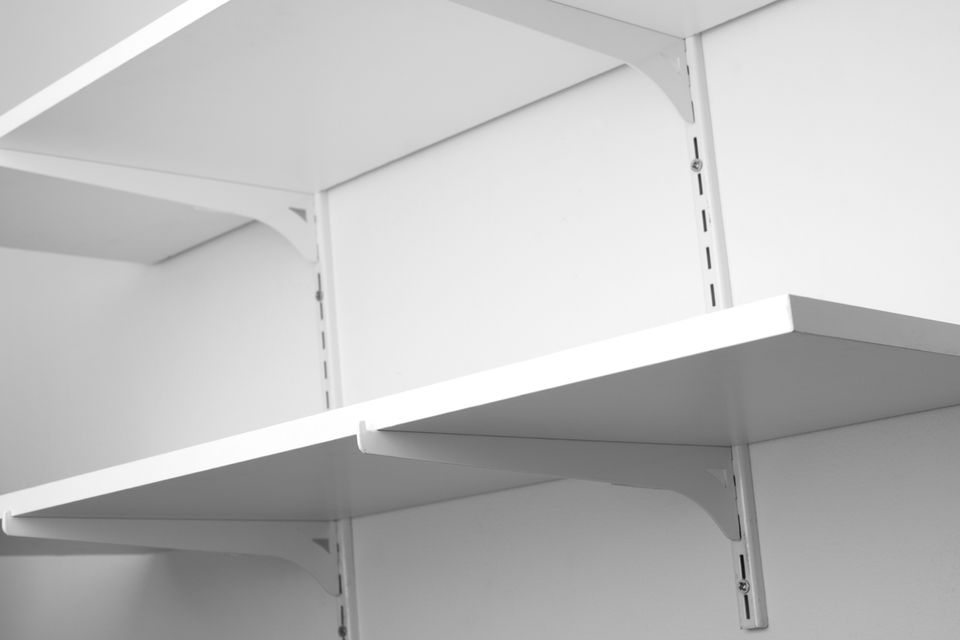 Shelves mounted to a wall using wall-mounted brackets