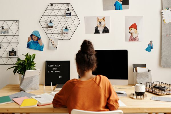 Girl doing homework at a home desk