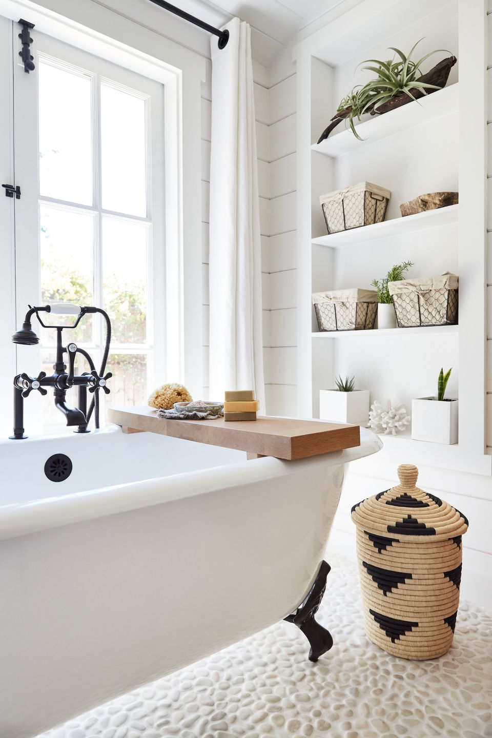 Bathroom with storage shelves and containers
