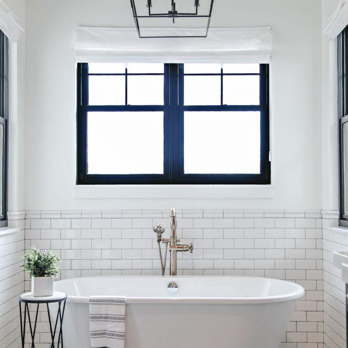 Cage chandelier in modern bathroom