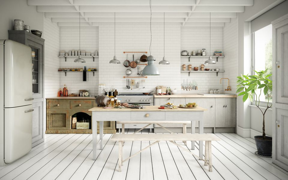 A white kitchen with rustic accents.