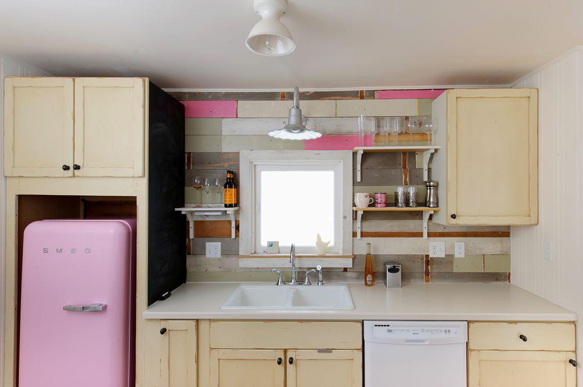 retro kitchen with pink fridge