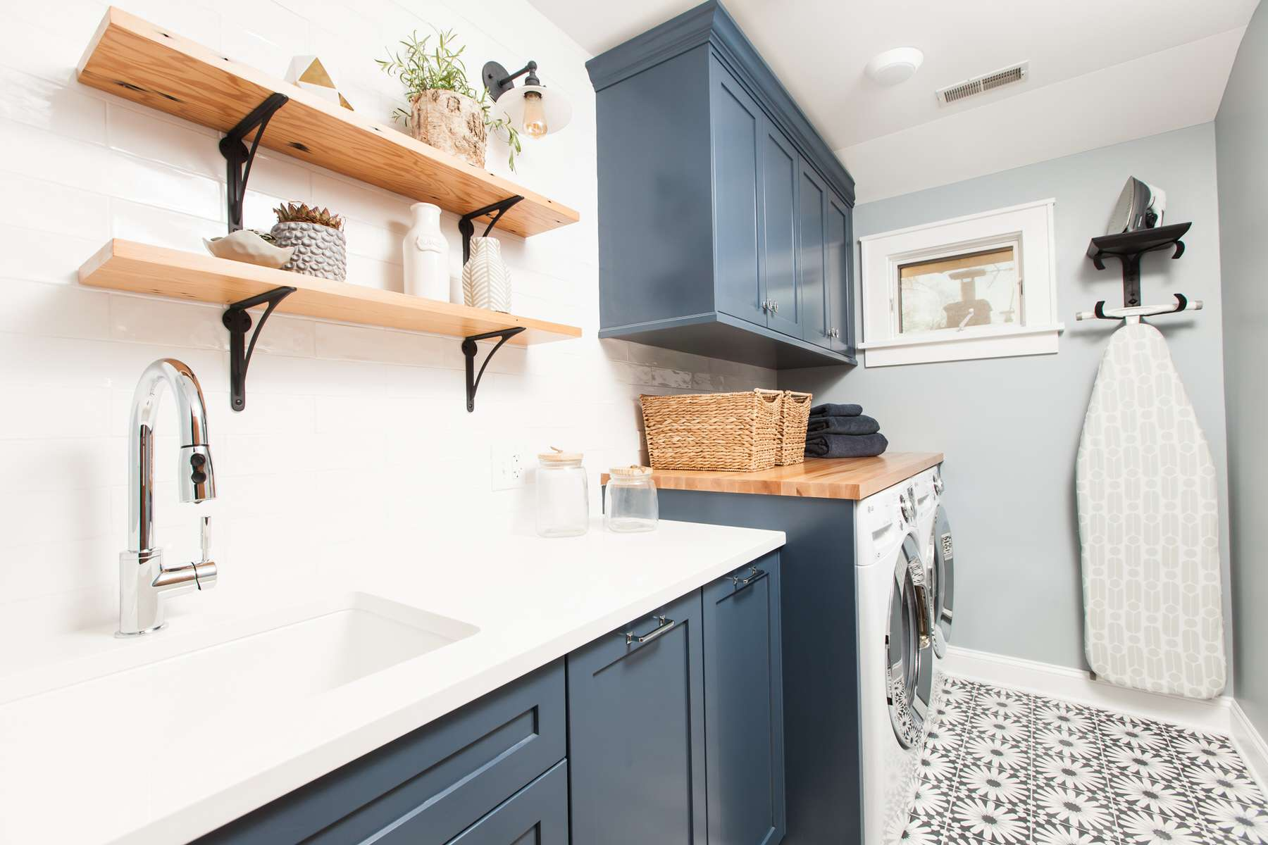 modern laundry room with patterned floor tile