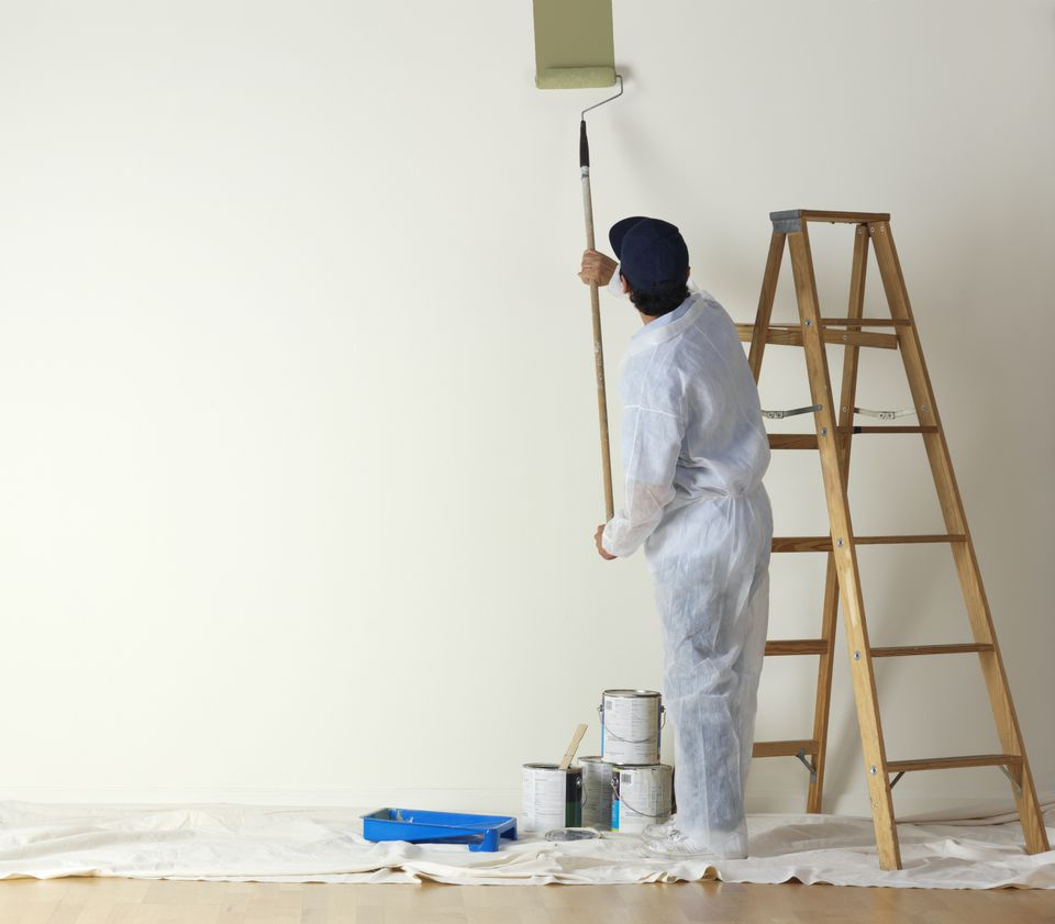 Painter painting a room