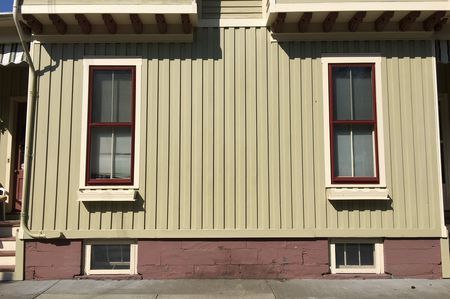 Vertical Siding Two Elongated Windows Over Cellar And Below Bay The Symmetry Of Board Batten