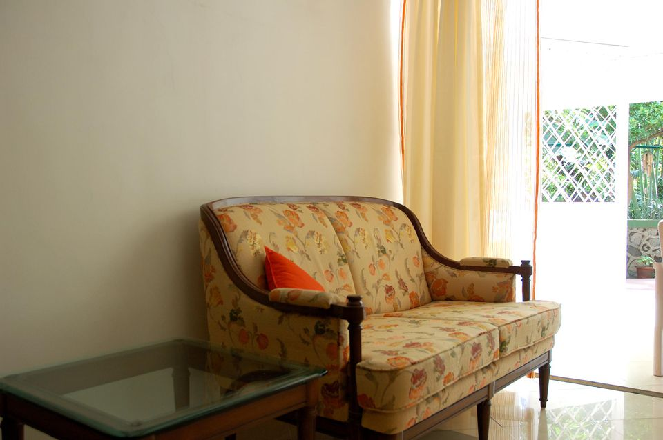 Old sofa in a sunny room