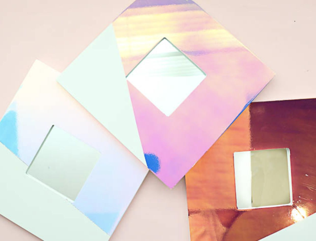 a DIY mirror frame made using holographic contact paper