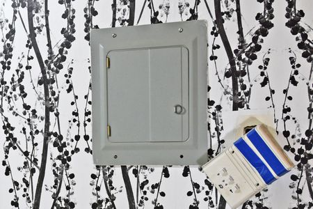 Hide Your Ugly Electrical Panel With This IKEA Ways To Cover Electrical Panel on