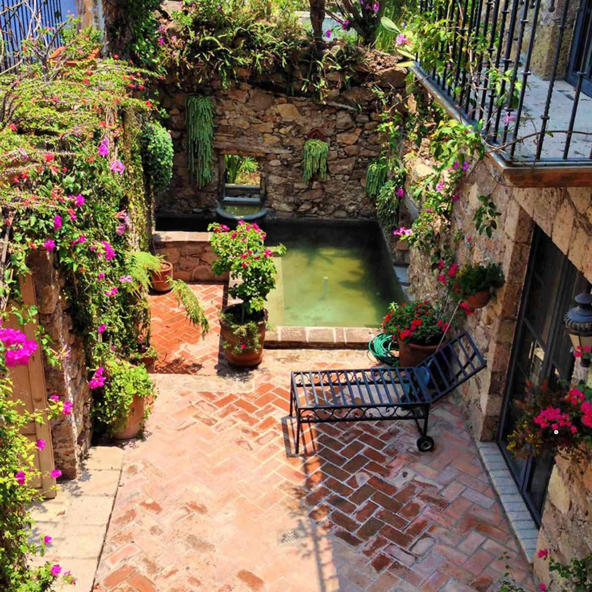 Walled gardens along brick walkway in Mexico