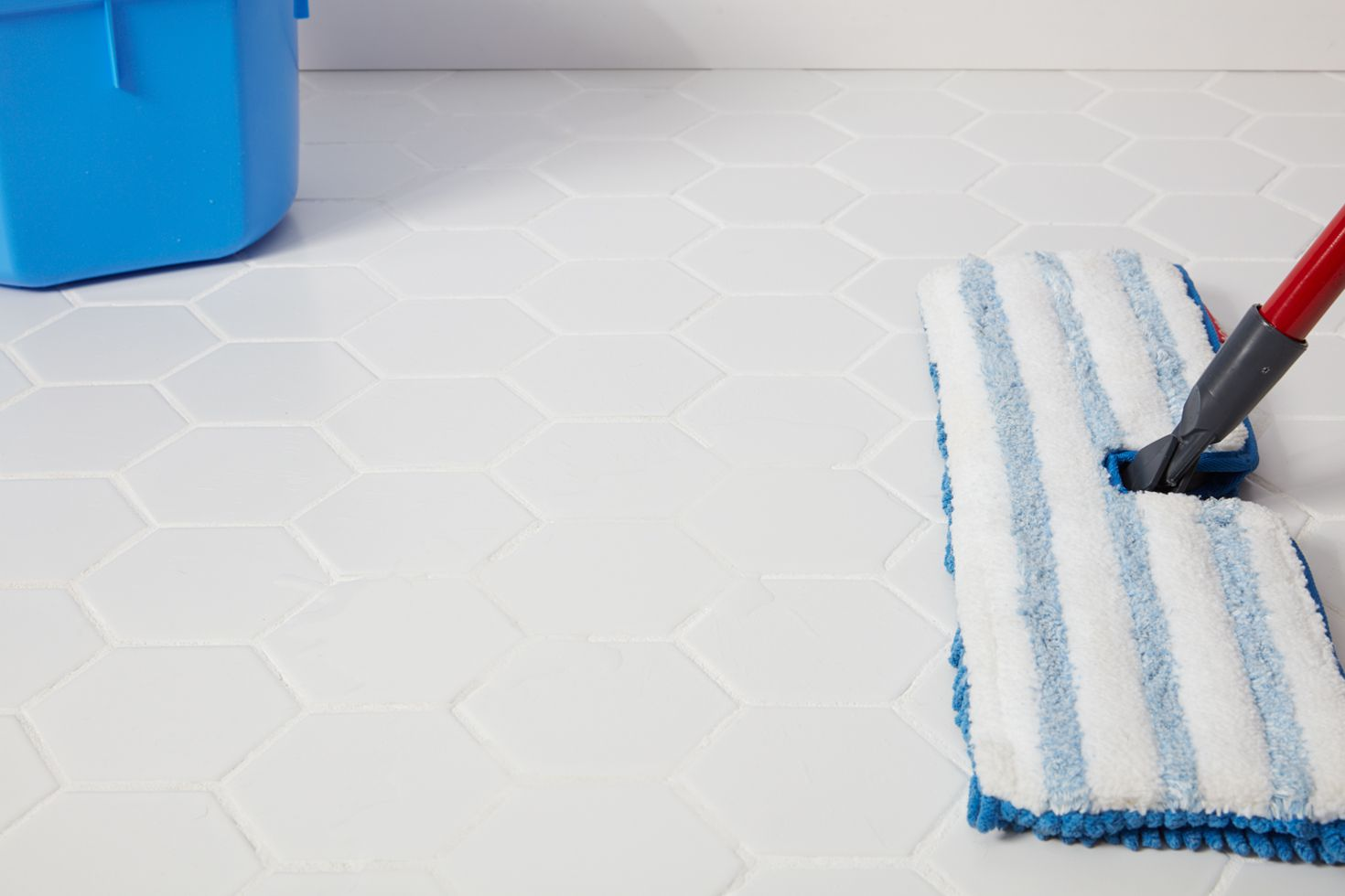 Cleaning tile floor with microfiber mop