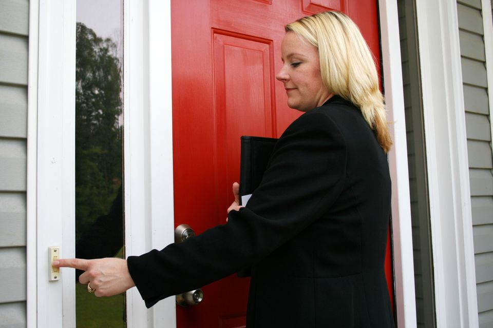 woman ringing doorbell