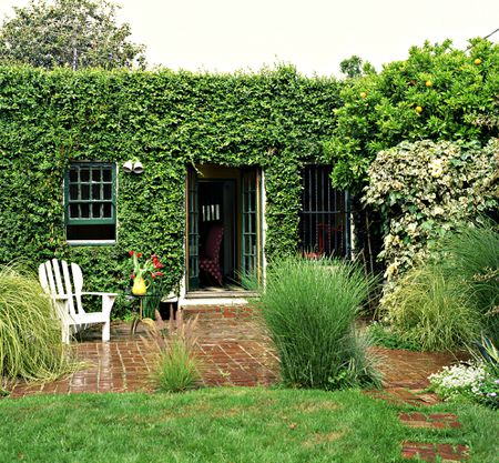 Red Brick Flooring Blends Nicely With This Lush Eclectic Vine Covered Dwelling Getty Images