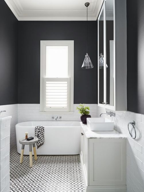 Bathroom with half black and white walls
