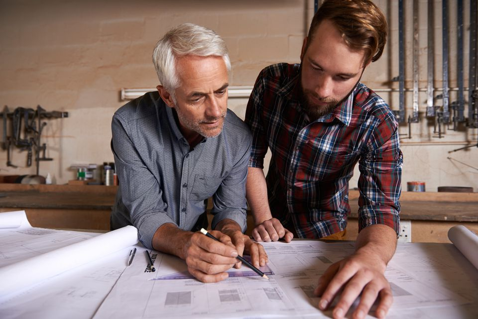 Two men looking at a free garage plan