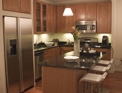 Secrets to finding cheap kitchen cabinets save big by buying used showroom display cabinets kitchen design tips solutioingenieria Choice Image