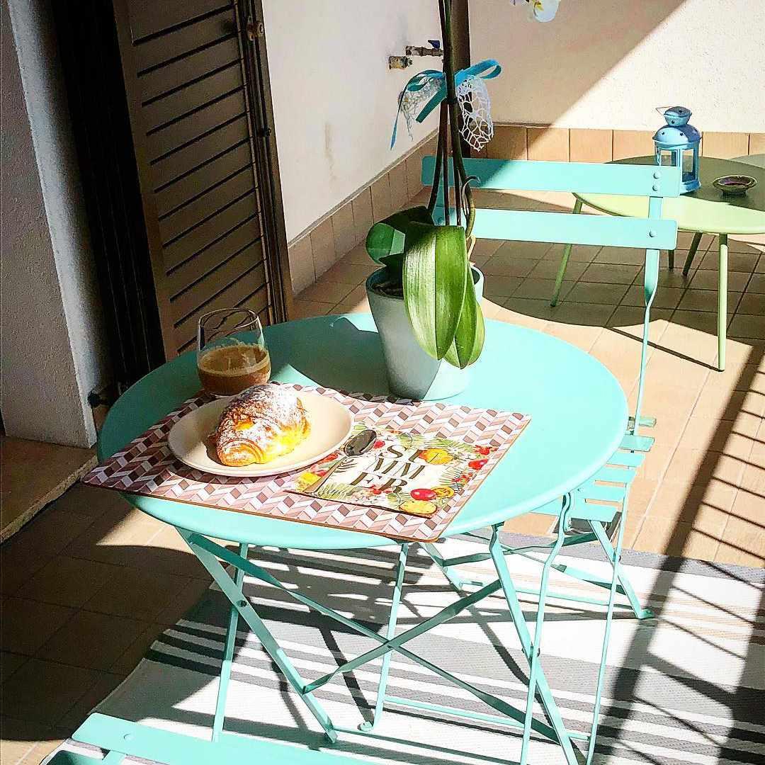 Classic bistro set on balcony