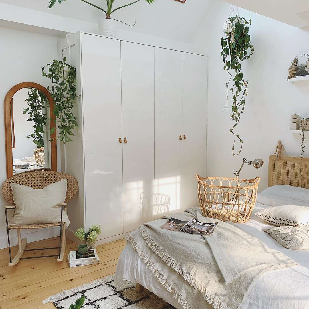 Bedroom with plants and wicker furniture