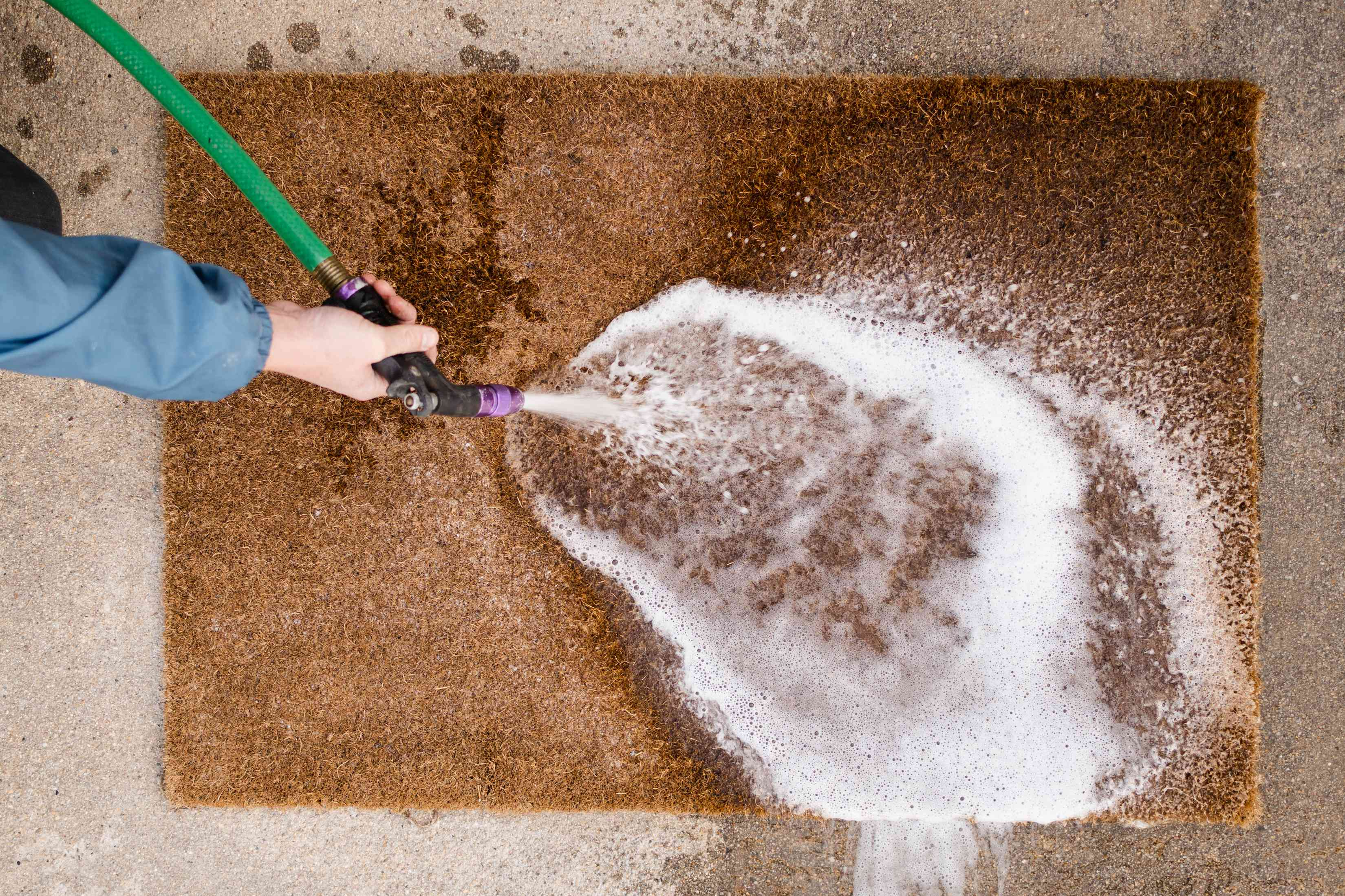 Brown doormat washed down with garden hose