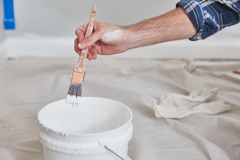 Dab paintbrush into paint