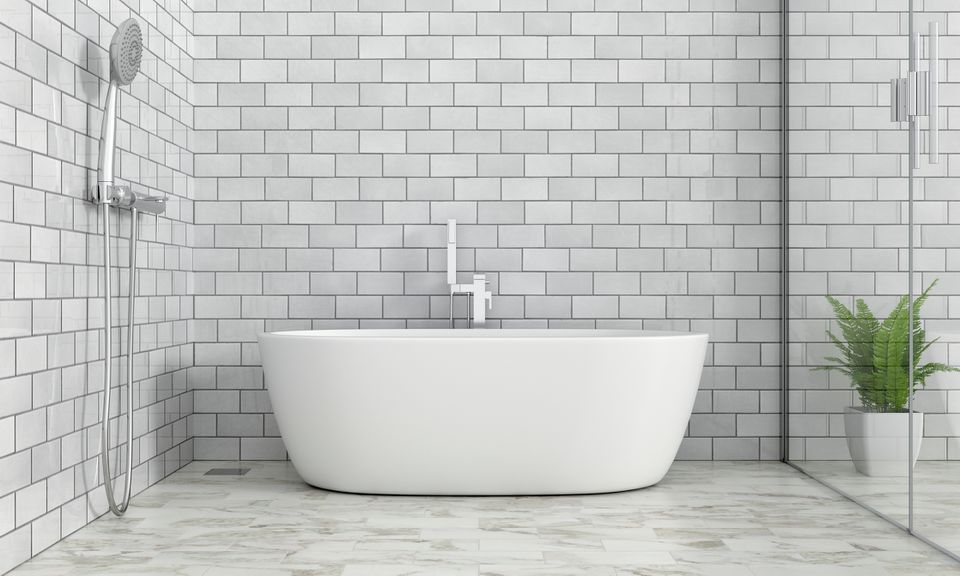 Bath tub with gray tiles