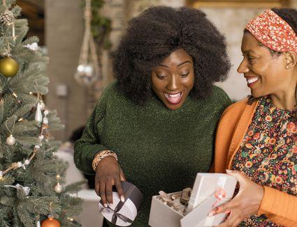 women opening presents