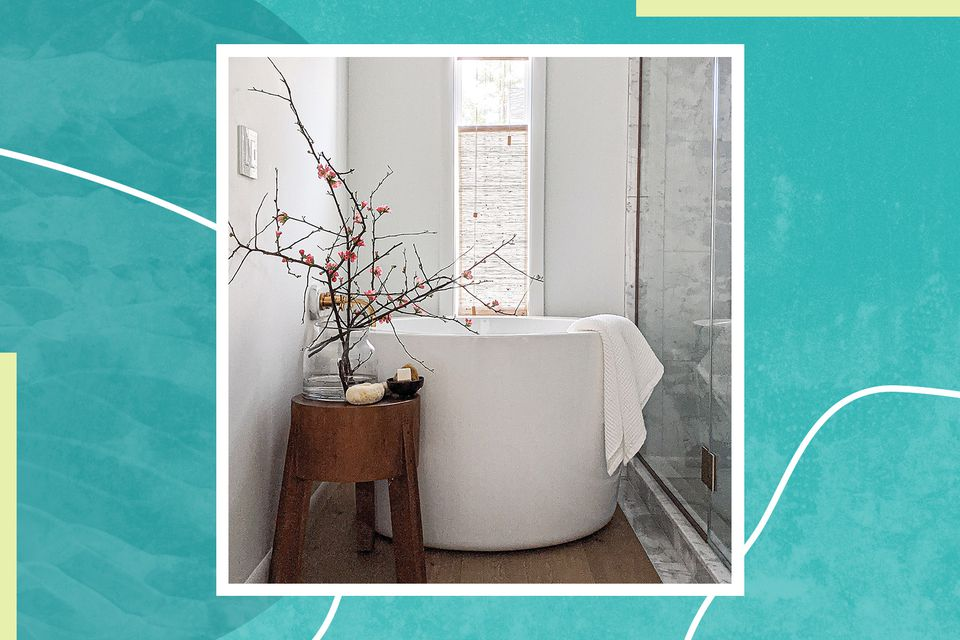 The primary bathroom of the Shaker Heights Home of Molly & Fritz features a Japanese soaking tub
