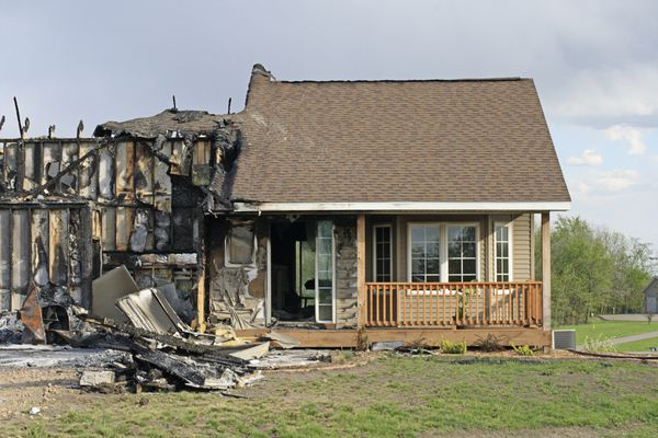 Front view of fire-damaged home